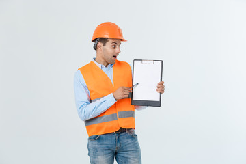 Engineers examining documents on clipboard isolated over white background.