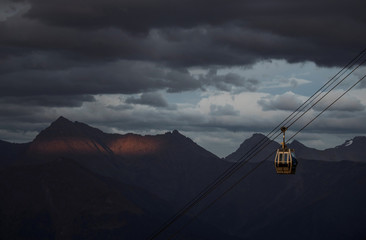 A cable car is pictured with Caucasus mountains during sunset in the background outside Krasnaya Polyana near Sochi