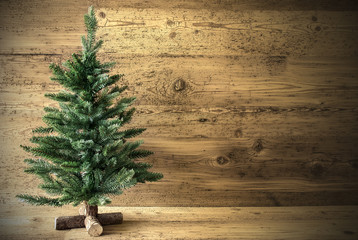 Green Christmas Tree On Brown Vintage Background