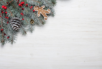 Christmas card. White wooden background with snow fir tree and decoration. Top view with copy space for your text