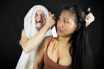 Evil Demon Zombie Ghost Monster Stabbing A Woman In The Neck Isolated On Black Background