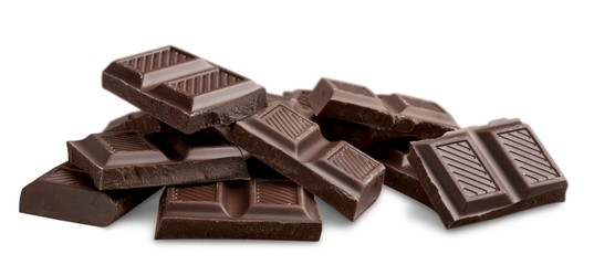 Pieces of delicious chocolate isolated on white background