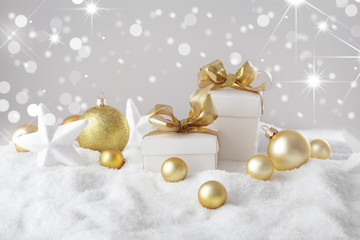christmas gift boxes, ornaments and snow