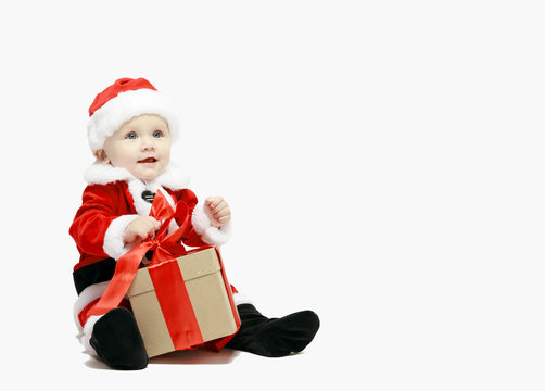 Santa Claus baby in red christmas clothes with gift box isolated on white