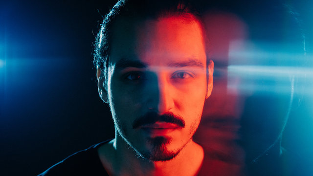 Cinematic portrait of man with lights and prism