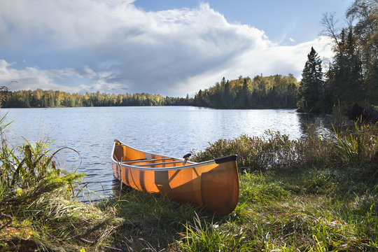 Canoe on the shore of a northern Minnesota lake during autumn