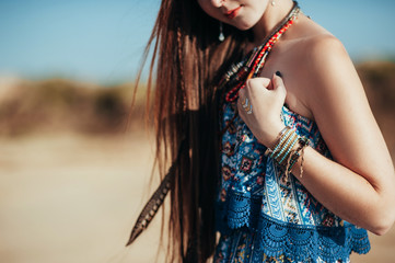 close up of attractive young woman wearing boho accessories