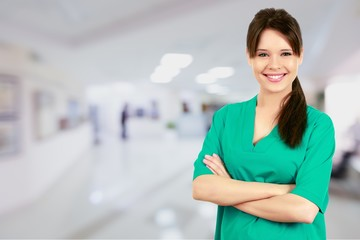 Young nurse woman with stethoscope at hospital