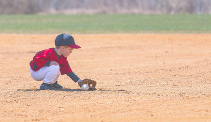 Child Fields a Ground Ball During a Baseball Game