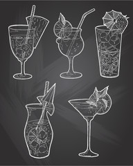 Hand drawn sketch ice alcoholic cocktails set with a slice of lemon and a umbrella and strawberry vintage . Vector for coctail menu in chalkboard background. Hand drawn design element