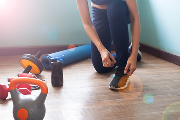 Woman tying shoes for exercise, Healthy lifestyle