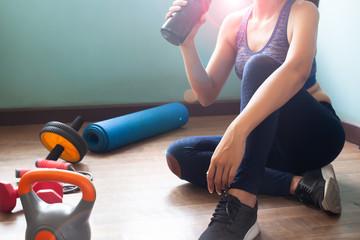 Woman in sportswear drinking protein shake, Healthy