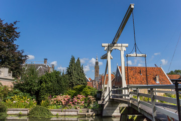 Wall Mural - Wooden bridge and church tower in Edam, Netherlands