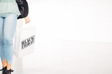 Girl holds black friday shopping bag