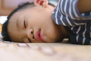 Sleeping Asian baby with stuffy nose.