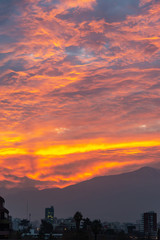 Wall Mural - Santiago de Chile, dramatic sky at sunset, andes mountainsin the background