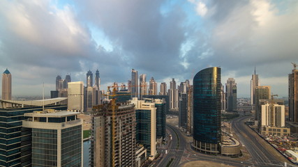 Dubai business bay towers early morning aerial timelapse.