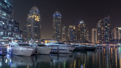 Dubai marina bay with yachts an boats night timelapse