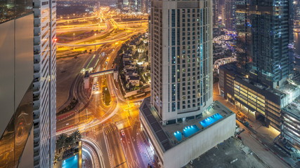 Aerial view of a road intersection in a big city day to night timelapse.