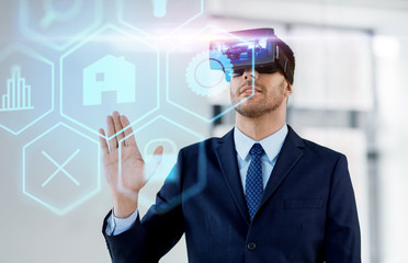 business, technology and augmented reality concept - businessman with vr headset and hologram of menu icons at office