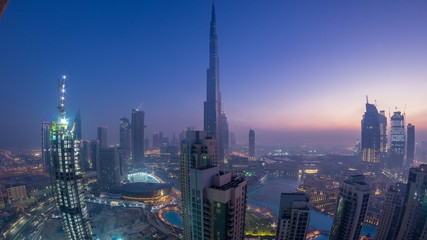Foggy morning in downtown of Dubai night to day timelapse.