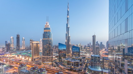 Dubai downtown skyline day to night timelapse with tallest building and Sheikh Zayed road traffic, UAE
