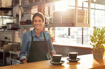 Waitress at cafe counter