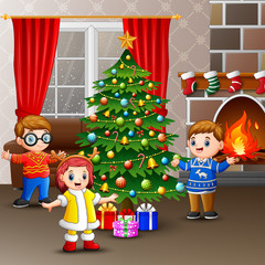 Happy kids celebrating christmas in the house
