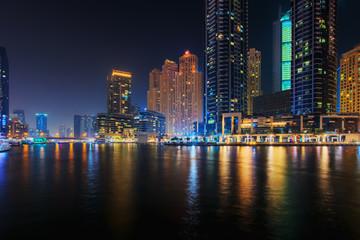 Beautiful view to Dubai Marina Promenade, UAE. Long exposure effect at night
