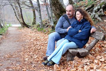 Mature couple sitting on a park bench, Plitvice Lakes National Park, Croatia