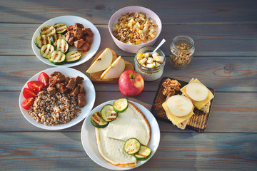 Health Fitness Food in lunch boxes. Set meal for the whole day.