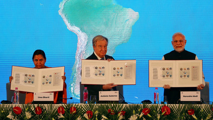 Indian Minister for Drinking Water and Sanitation Bharati, UN Secretary General Guterres and India's PM Modi release postage stamps during the closing function of the Mahatma Gandhi International Sanitation Convent