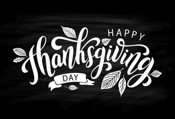 Happy thanksgiving day with autumn leaves. Hand drawn text lettering. Vector illustration. Script. Calligraphic design for print greetings card, shirt, banner, poster. Black chalkboard and white words