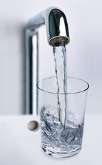 Filling water from the tap into a glass