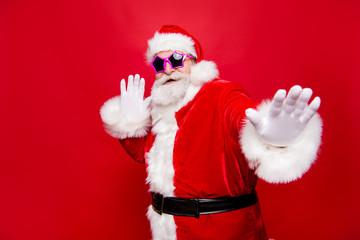 Kind cheerful positive stylish fooling around aged Santa in trad