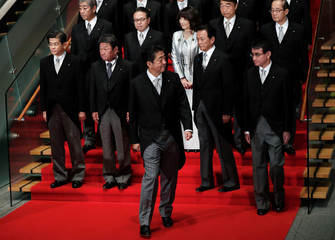 Japan's Prime Minister Shinzo Abe leaves a photo session with his cabinet ministers at his official residence in Tokyo