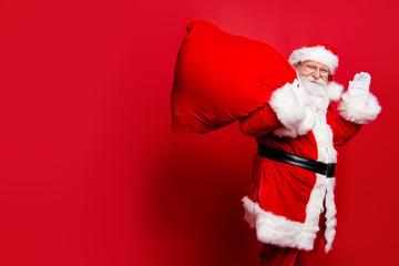 Cheerful nice peaceful Santa in eyeglasses wishes you merry Chri