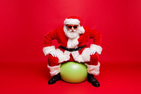 Funny positive stylish fashionable Santa in eyeglasses gloves fu
