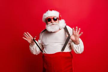 Portrait of cheerful positive dreamy funky Santa congratulations