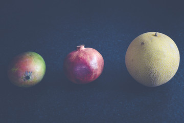fresh bio fruits pomegranate mango melon