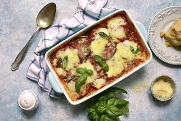 Italian eggplant dish melanzane alla parmigiana.Top view with copy space.