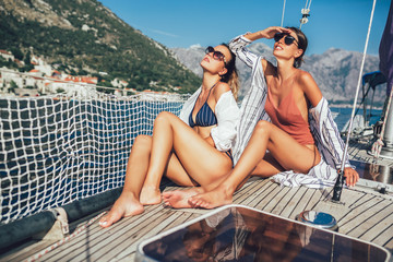 Girls enjoy the vacation on a yacht. Party on a sailboat.