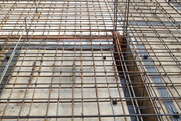 reinforcement of concrete with metal rods connected by wire. Preparation for pouring the slab and column