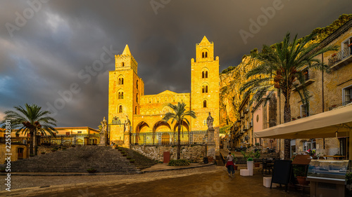 Wall mural The Cathedral of Cefalu in golden sunset light after rain, Sicily island, Italy