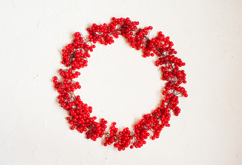 Autumn composition with red berry. Wreath made of viburnum berries. Flat lay, top view, copy space