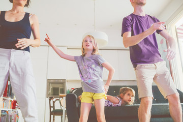 Family dancing together indoor- comforting, love, bonding concept