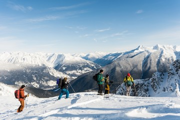 Group of skiers standing on a snowy mountain