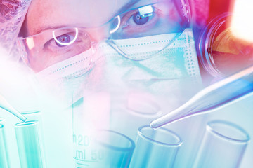 Medical scientist working with laboratory glassware