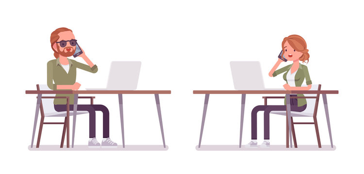 Young red-haired man and woman sitting and working at desk