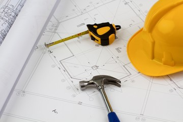 Construction tools - hard hat, hammer and measuring tape on top
